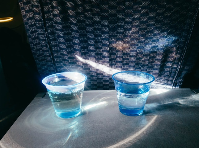 13. On long-haul flights, you are often offered free wine, beer, and alcohol, depending on the airline. I have made the mistake of drinking twice on 12-plus hour flights. Both times, I ended up with debilitating headaches halfway through. Skip the alcohol.