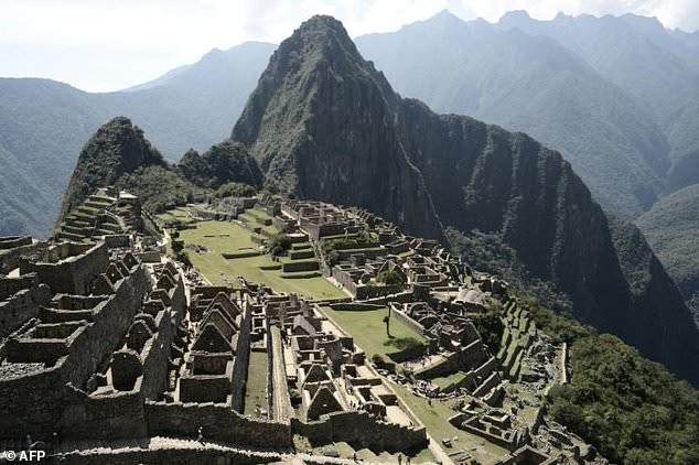 The Historic Sanctuary of Machu Picchu is embedded within a dramatic landscape at the meeting point between the Peruvian Andes and the Amazon Basin